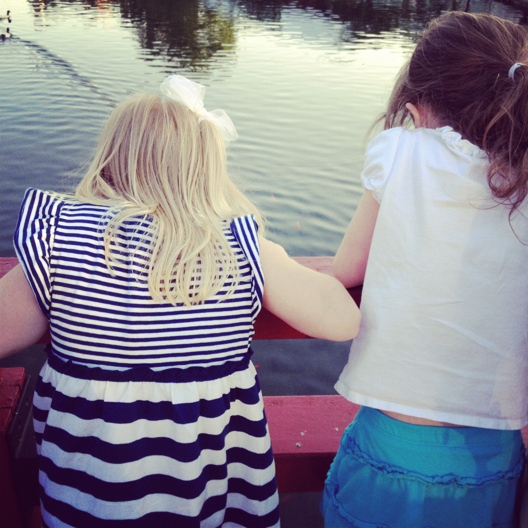 The girls looking at the ducks
